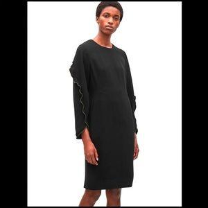 COS - Black dress with green ruffle trim